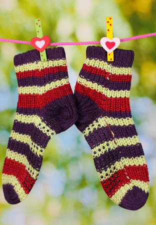 Pair of knit striped socks hanging to dry Stock Photo - 16220460