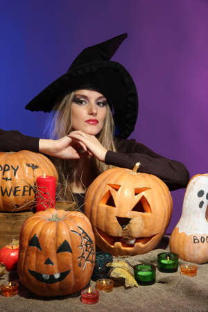 Halloween witch with pumpkins on color background Stock Photo - 16547035