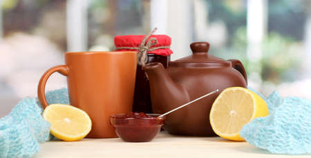 convalesce: Helpful tea with jam for immunity on wooden table on window background