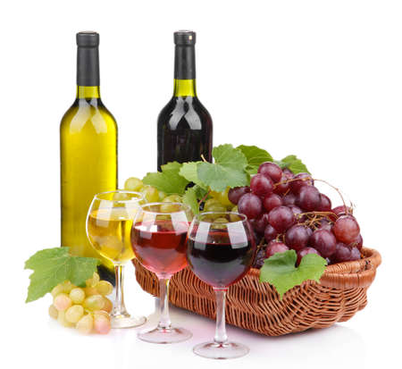 bottles and glasses of wine and grapes in basket, isolated on white Stock Photo