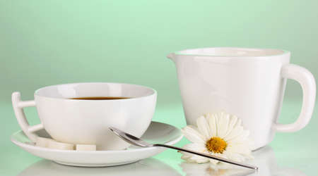 A cup of strong coffee and sweet cream on green background Stock Photo - 16219463