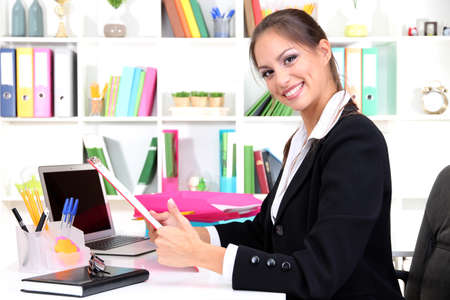 Young pretty business woman at workplace Stock Photo - 16546618