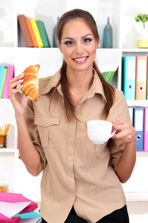 business woman has snack photo
