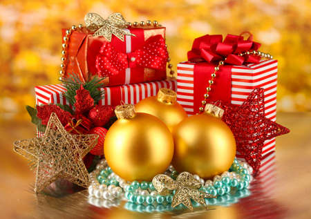 Christmas decoration and gift boxes on golden background photo