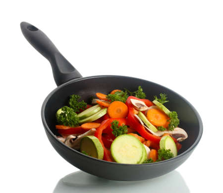 panful: frying pan with vegetables on white Stock Photo