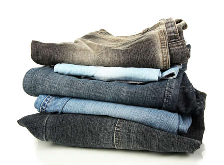 Lot of different jeans isolated on white photo