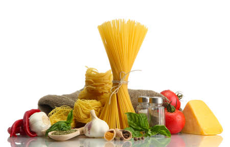 Pasta spaghetti, vegetables and spices, isolated on white Stock Photo - 16275708