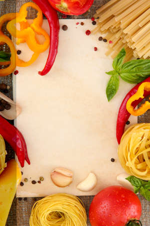paper for recipes, spaghetti with vegetables and spices, on sacking background photo