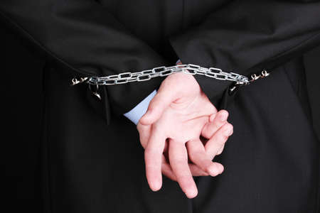 Businessman hands fettered with chain photo