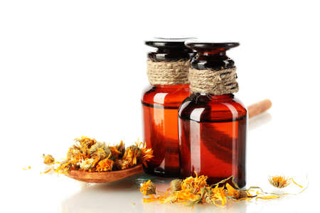 medicine bottles and dried calendula flower, isolated on white photo