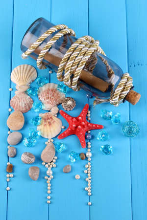 Decor of seashells close-up on blue wooden table photo