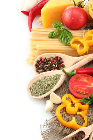 italian culture: Pasta spaghetti, vegetables and spices, isolated on white