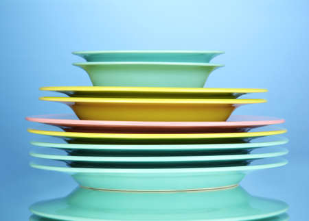 Color plates on blue background photo