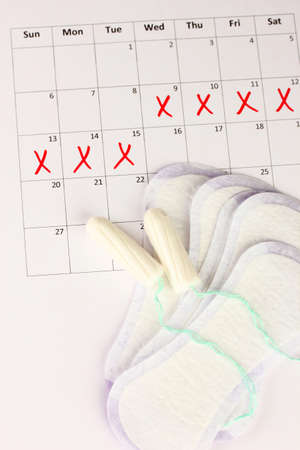 menstruation calendar with sanitary pads and tampons, close-up Stock Photo - 16317964