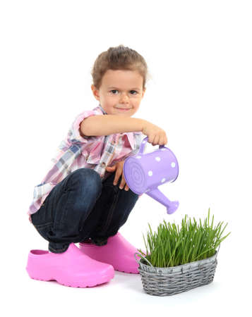 beautiful little girl with watering can isolated on white Stock Photo - 16547539