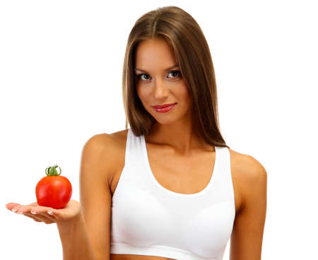 beautiful young woman with tomato, isolated on white photo