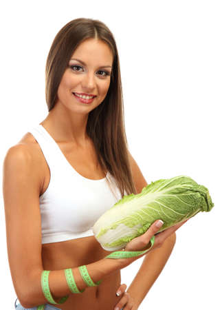 beautiful young woman with  cabbage and measure tape, isolated on white photo