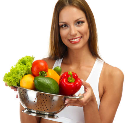beautiful young woman with vegetables in colander, isolated on white Stock Photo - 16546664