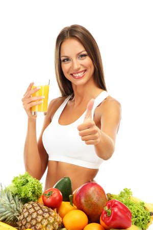 beautiful young woman with fruits and vegetables and glass of juice, isolated on white Stock Photo - 16546676