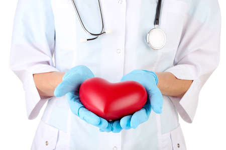 Doctor with heart in hand. isolated on white Stock Photo - 16314792
