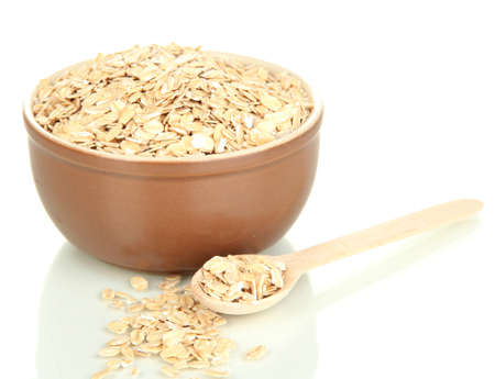 Brown bowl full of oat flakes flakes with wooden spoon isolated on white Stock Photo - 16311424
