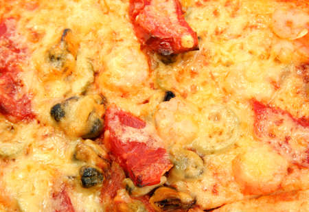 tasty pizza with shrimps and mussels close-up photo
