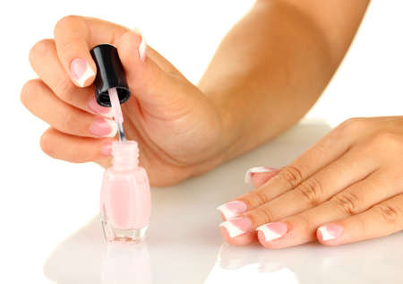 Woman makes herself a French manicure, on white background Stock Photo - 16344535