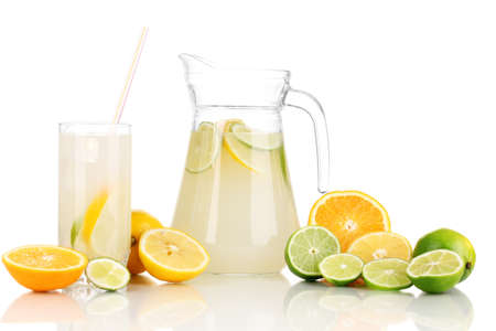 Citrus lemonade in pitcher and glass of citrus around isolated on white Stock Photo - 16344676