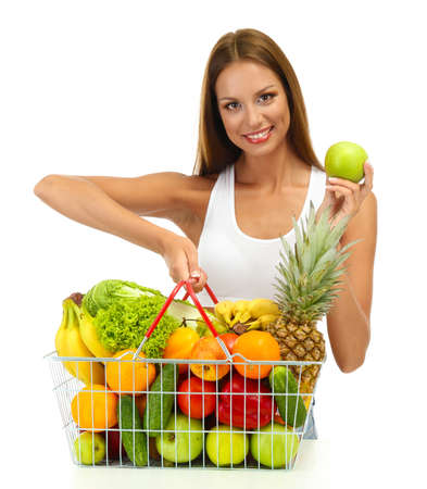 beautiful young woman with fruits and vegetables in shopping basket, isolated on white Stock Photo - 16546501