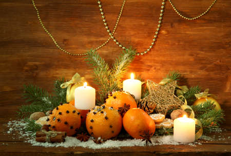 christmas composition with oranges and fir tree, on wooden background photo