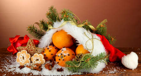 christmas composition with oranges and fir tree in Santa Claus hat Stock Photo - 16343911