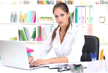 Young pretty business woman with notebook in office Stock Photo - 16546524