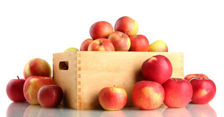 juicy apples in wooden crate, isolated on white photo