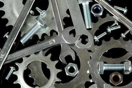 bolts and nuts: Machine gear, metal cogwheels, nuts and bolts background, close-up