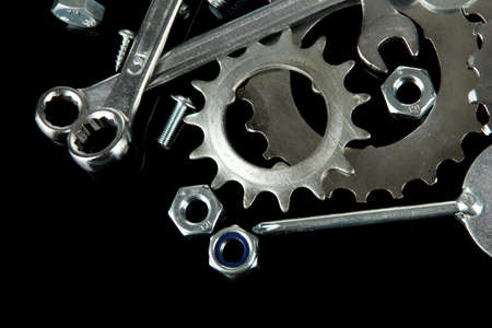 Machine gear, metal cogwheels, nuts and bolts isolated on black Stock Photo - 16344258