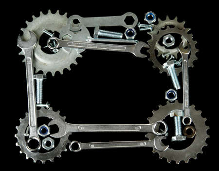 Machine gear, metal cogwheels, nuts and bolts isolated on black Stock Photo - 16344246