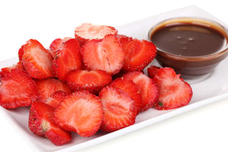 Fresh strawberries on plate with chocolate close-up Stock Photo - 16341286