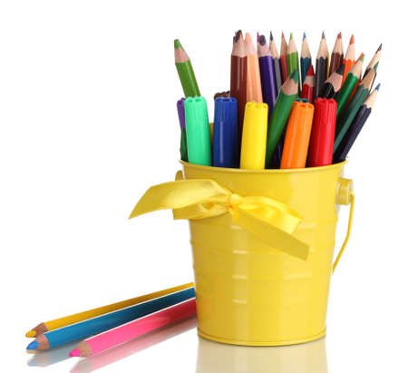 Colorful pencils and felt-tip pens in yellow pail isolated on white photo