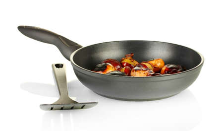 buckeye seed: roasted chestnuts in the pan isolated on white