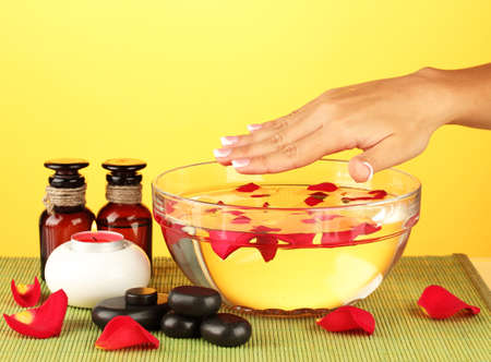 spa treatments for female hands,  on yellow background photo