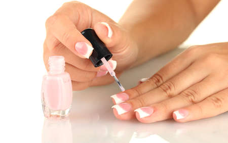 Woman makes herself a French manicure, on white background Stock Photo - 16342356