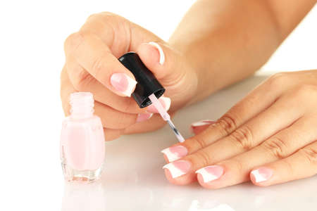 Woman makes herself a French manicure, on white background Stock Photo - 16342212