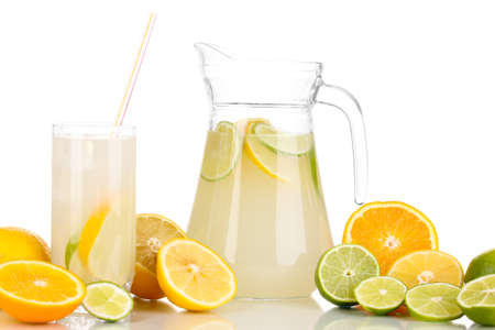 Citrus lemonade in pitcher and glass of citrus around isolated on white Stock Photo - 16343313
