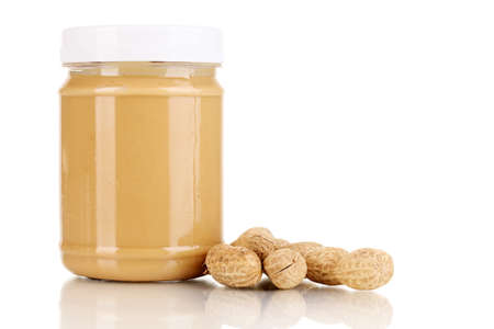 Delicious peanut butter in jar of peanut near isolated on white photo