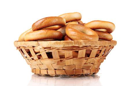 boublik: tasty bagels in basket, isolated on white Stock Photo