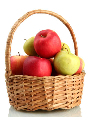 fruits basket: juicy apples in basket, isolated on white