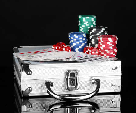 Poker set on a metallic case isolated on black background Stock Photo - 16435796