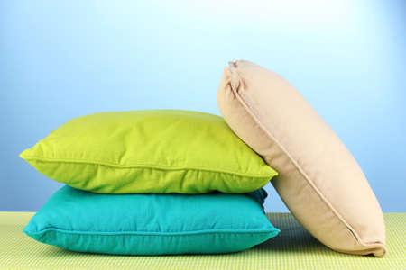 pillows on blue background Stock Photo - 16490176