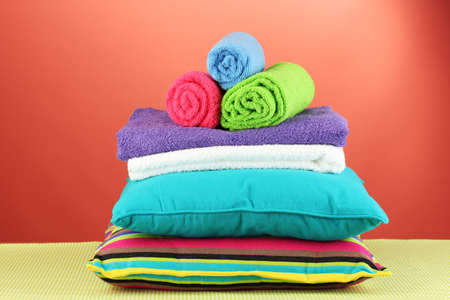 pillows and towels on red background photo