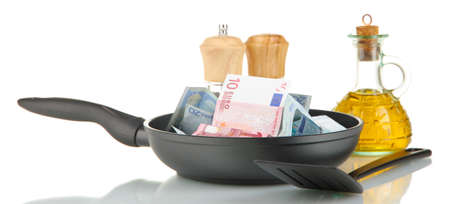 Banknotes in a frying pan with cooking spatula isolated on white Stock Photo - 16439752